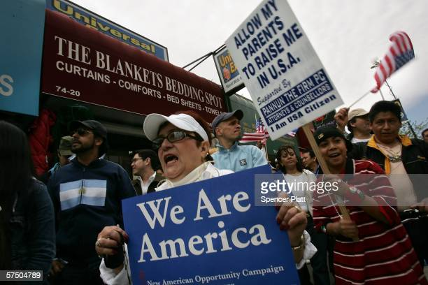 People hold signs as they participate in a proimmigrant demonstration May 1 2006 in the Queens borough of New York City Immigrants and their...