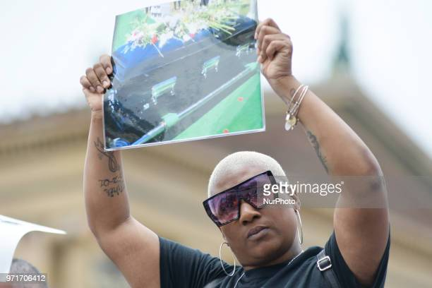People hold signs at an anti gun violence rally on the Art Museum steps in Philadelphia PA on June 11 2018 The 3rd annual Fill the Steps Against Gun...