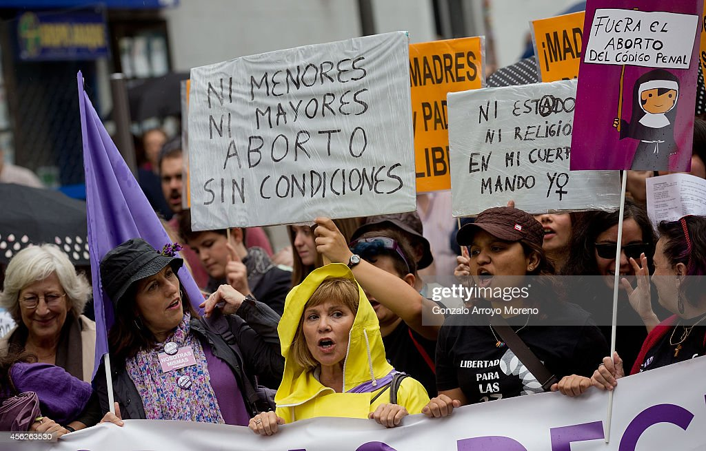 People hold signs during a demonstration supporting reproductive rights for women on September 28, 2014 in Madrid, Spain. During an international day supporting the decriminalization of abortion, thousands of people have celebrated the Spanish government's new abortion law withdrawal and the resignation of Justice Minister Alberto Ruiz-Gallardon. The protesters are also against Spanish government intentions to restrict the reproductive rights of female teenagers.