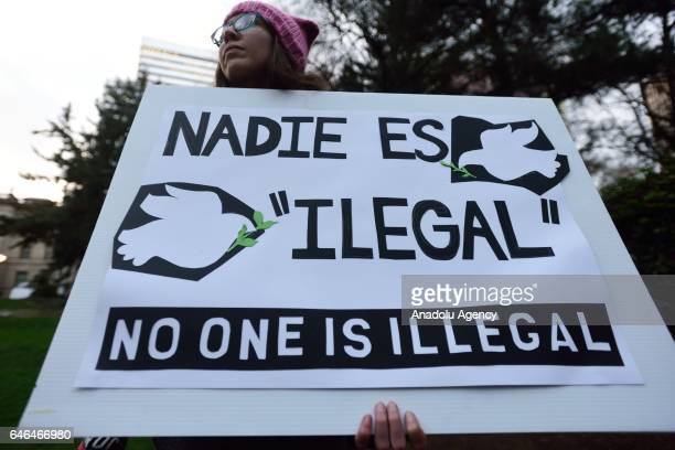 People hold signs during a rally in support of immigrant justice and the Deferred Action for Childhood Arrivals Obamaera immigration policy in...