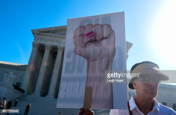 People hold signs during a rally to call for 'An End to Partisan Gerrymandering' at the Supreme Court of the United States on October 3 2017 in...