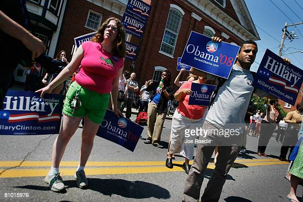 People hold signs in support of Democratic presidential hopefuls US Senator Hillary Clinton and Senator Barack Obama during her campaign event at...