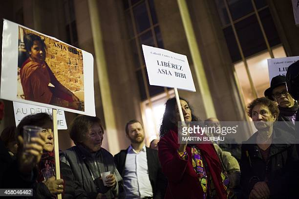People hold signs reading Free Asia Bibi as they demonstrate on the Parvis des droits de l'homme in Paris on October 29 to protest against the death...
