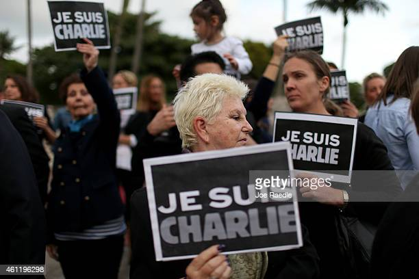 People hold signs reading 'Je Suis Charlie' to show their support for the victims of the terrorist attack at French magazine Charlie Hebdo on January...