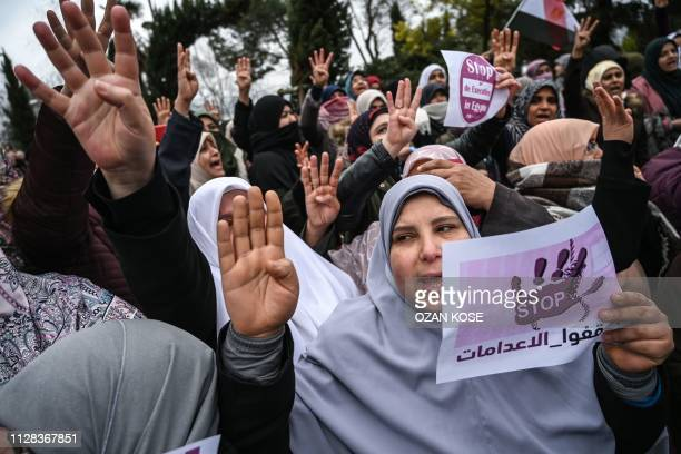"""People hold signs reading """"Stop executions in Egypt"""" in front of the Egyptian consulate in Istanbul on march 2, 2019 during a demonstration against..."""