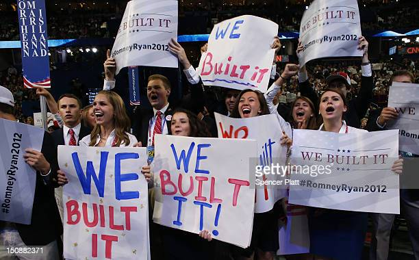 """People hold signs that read """"We Built It"""" during the Republican National Convention at the Tampa Bay Times Forum on August 28, 2012 in Tampa,..."""