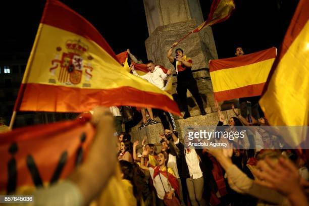 People hold Spanish flags and shout slogans as they gather to stage a demonstration to protest Catalonia's illegitimate independence referendum in...