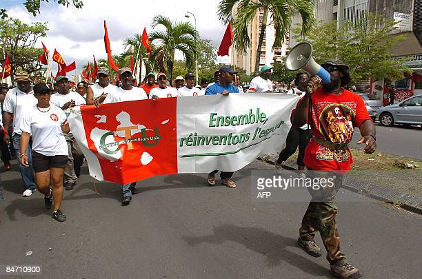 People hold the banner of CTU which reads 'Togetheir let us reinvent hope' as they demonstrate on February 9 2009 in PointeaPitre against the high...