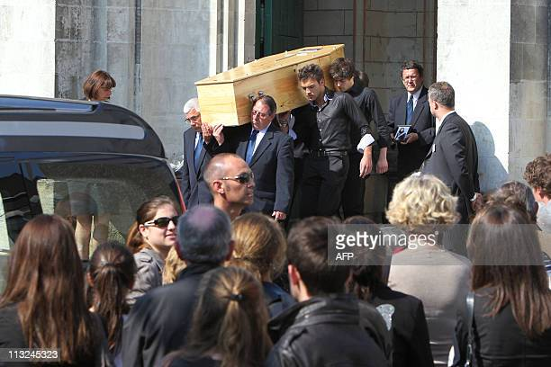 People hold the coffin of a member of the Dupont de Ligonnes family during the funeral ceremony on April 28 2011 in the French western city of Nantes...