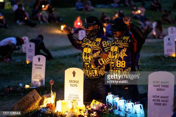People hold their breath for 8 minutes 46 seconds, to signify the amount of time that Minneapolis police officer, Derek Chauvin had his knee on...