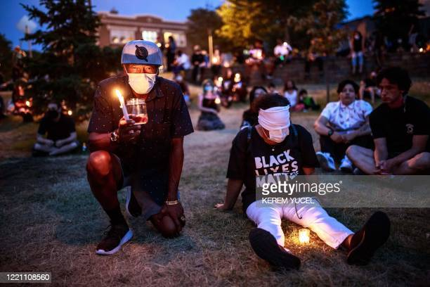 People hold their breath, some blindfolded, for 8 minutes 46 seconds, to signify the amount of time that Minneapolis police officer, Derek Chauvin...