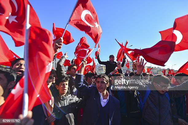 People hold Turkish Flags during a rally staged to pay tribute to the victims of the recent terrorist bombings in Turkey's Istanbul in Turkey's...