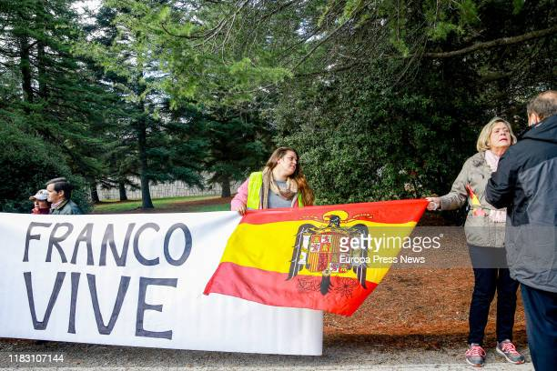 People hold up a banner that says 'Franco is alive' near Mingorrubio cemetery after Francisco Franco's exhumation on October 24 2019 in El Pardo...