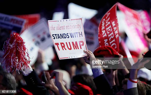 People hold up a sign in support of Republican presidential nominee Donald Trump during the election night event at the New York Hilton Midtown on...
