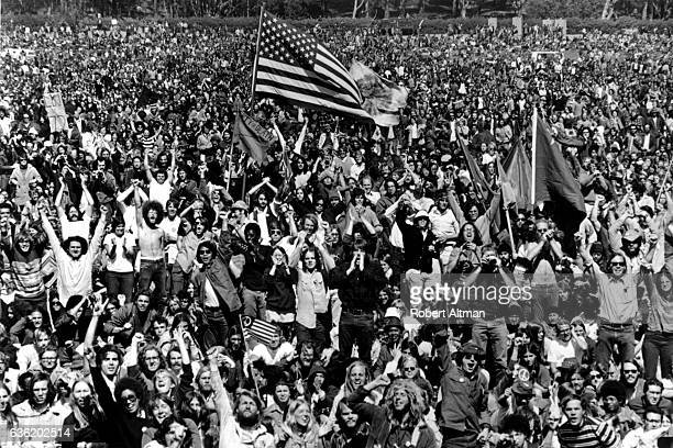 People hold up American flags and protest to Free the Presidio 27 Demonstration circa March 1969 in San Francisco California Presidio mutiny was a...