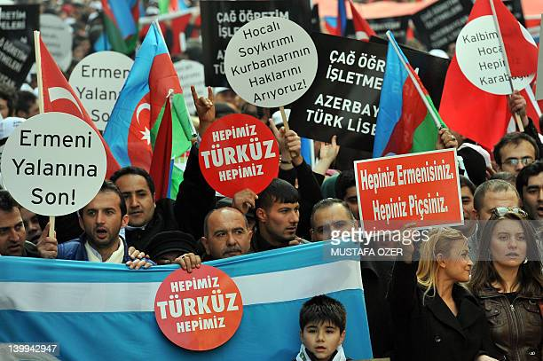 People hold up antiArmanian banners as they demonstrate in Istanbul's central Taksim square on February 26 to commemorate the 20th anniversary of the...