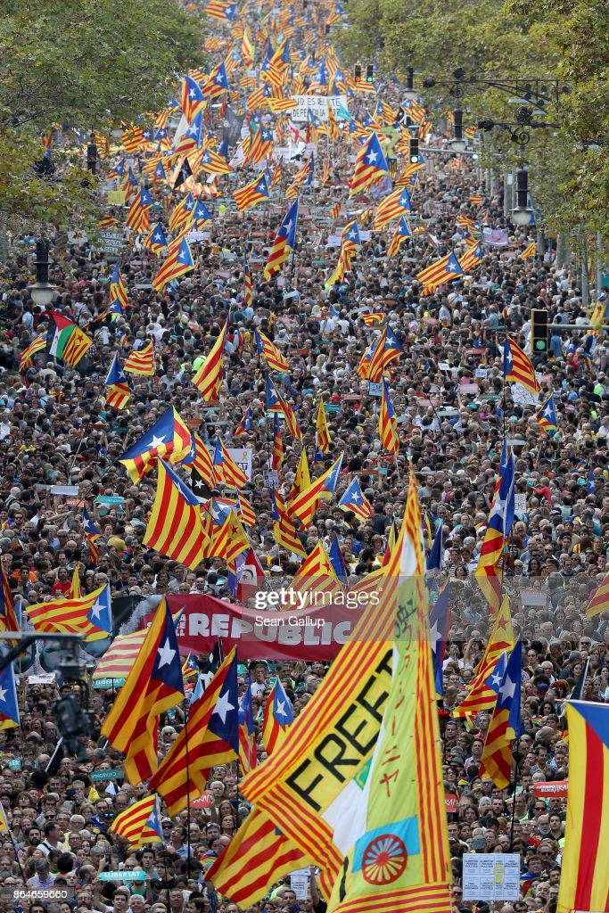 People hold up Catalan independence flags at a Catalan independence rally to demand the release of imprisoned Catalan leaders Jordi Sanchez and Jordi Cuixart on October 21, 2017 in Barcelona, Spain. The Spanish government announced measures today it will implement in triggering Article 155, which would lead to the imposition of direct rule by Spanish authorities in Catalonia and at least temporarily suspend the region's autonomy. The government also plans to hold Catalan regional elections in January. The moves come after Catalan regional President Carles Puigdemont let a Thursday deadline today pass and threatened to go forward with Catalan independence.