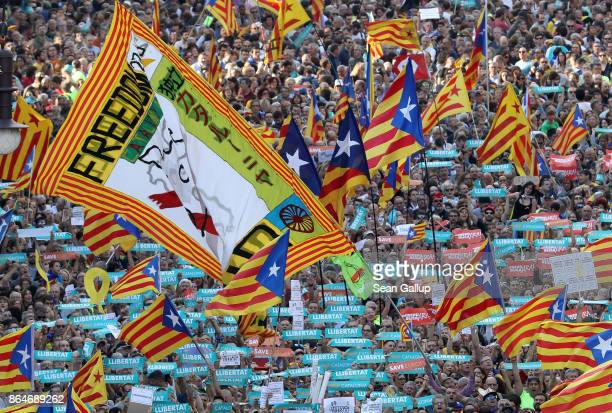 People hold up Catalan independence flags at a Catalan independence rally to demand the release of imprisoned Catalan leaders Jordi Sanchez and Jordi...