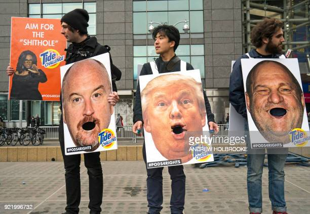 People hold up images of accused sexual predators Harvey Weinstein Woody Allen President Trump Louis CK and Tide Challenge during the Women's March...