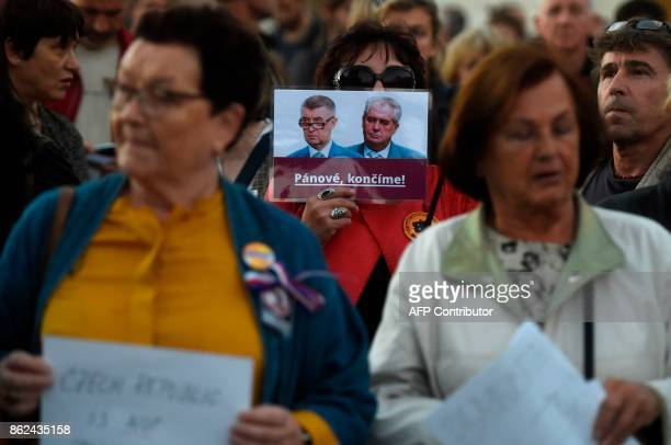People hold up placards during a demonstration against Czech President Milos Zeman and Former Czech Finacial Minister and leader of the ANO Party...