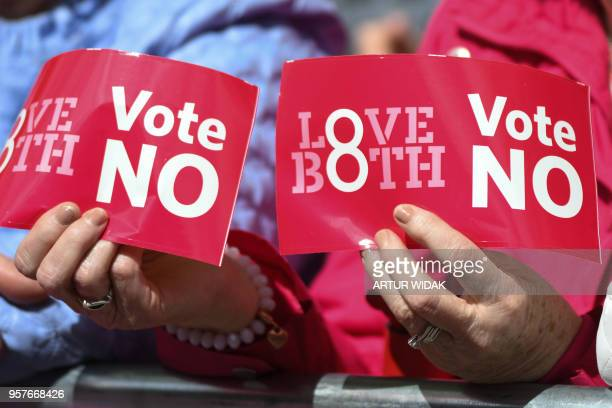 People hold up placards during a Stand up for Life rally calling for a 'no' vote in the upcoming referendum to preserve the eighth amendment of the...