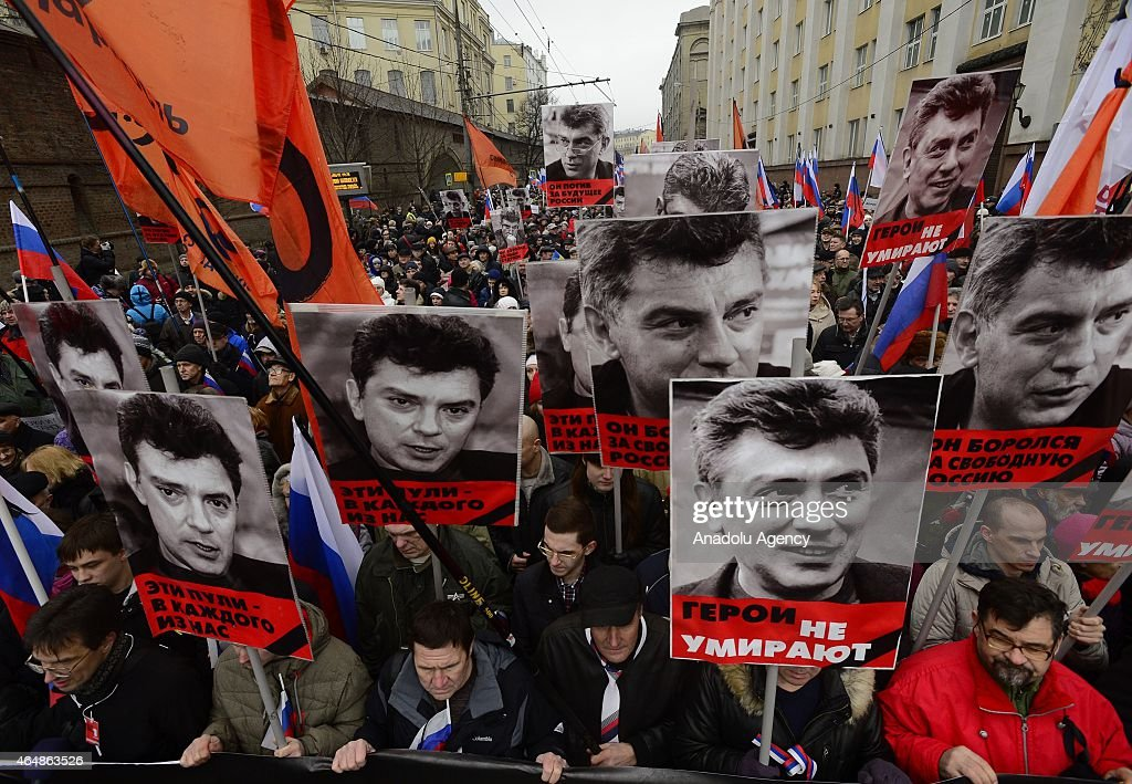 People hold up portraits of Russian opposition leader Boris Nemtsov as they march in memory of him on March 01, 2015 in Saint-Petesrburg, Russia. Russian opposition leader was shot dead in central Moscow late Friday in Moscow.