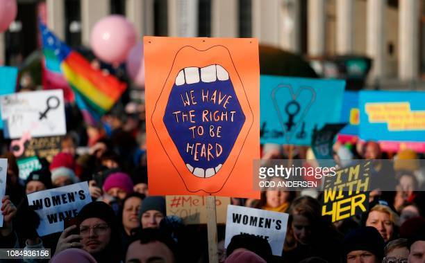 """People hold up posters reading among others """"We have the right to be heard"""" as they take part in a Women's March on January 19, 2019 in Berlin. - The..."""