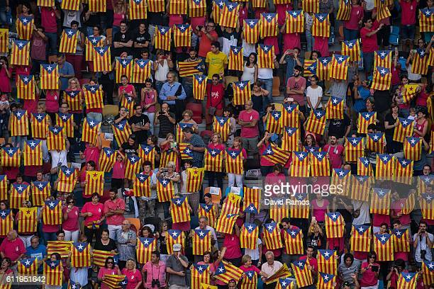 People hold up ProCatalan independence placards during the 26th Tarragona Competition on October 2 2016 in Tarragona Spain The 'Castellers' who build...