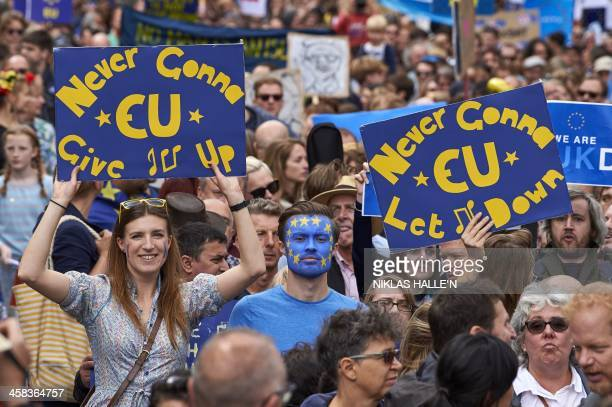 People hold up proEurope placards as thousands of protesters take part in a March for Europe through the centre of London on July 2 to protest...