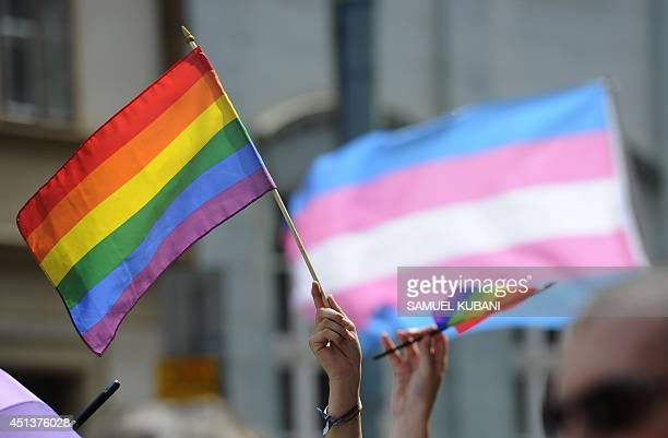 People hold up rainbow flags as they demonstrate during the lesbian gay bisexual and transgender Rainbow Pride Parade in Bratislava Slovakia on June...