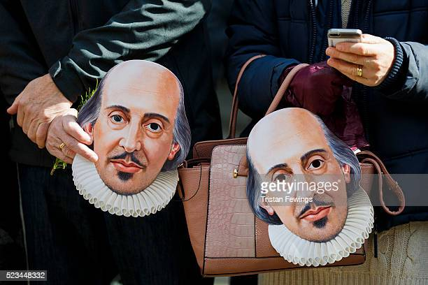 People hold William Shakespeare masks during the Shakespeare Birthday Celebration Parade on April 23 2016 in StratforduponAvon England This year the...