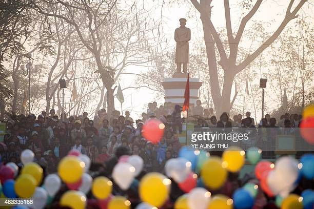 People holding balloons attend a ceremony to mark the 100th birthday of independence hero Aung San in the remote central Myanmar town of Natmauk on...