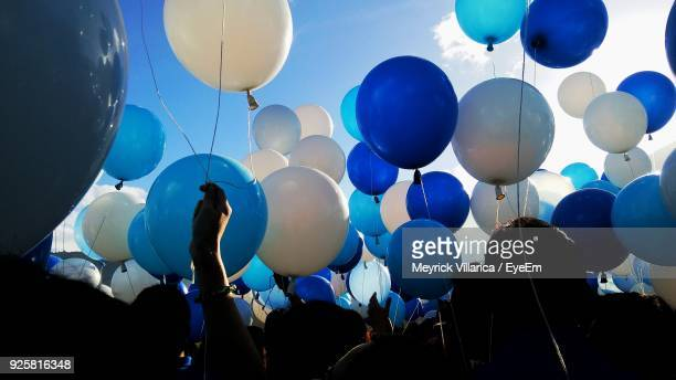 people holding balloons - blue stock pictures, royalty-free photos & images