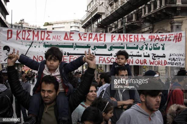 People holding banner and shouting slogans at the demonstration Demonstration for the International action day against racism fascism war and poverty...