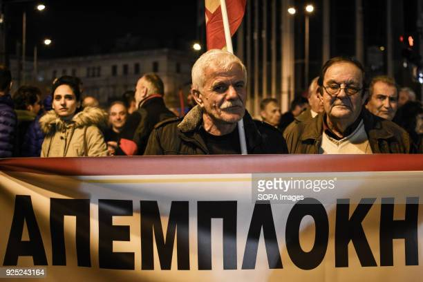 People holding banner and shouting slogans during the demonstration Demonstration at Syntagma Square in Athens as general secretary of the Communist...
