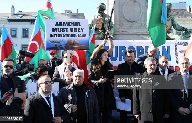 People holding banners and Azerbaijani flags gather to protest Khojaly Massacre within the 27th anniversary of 'Khojaly Massacre' which happened in...