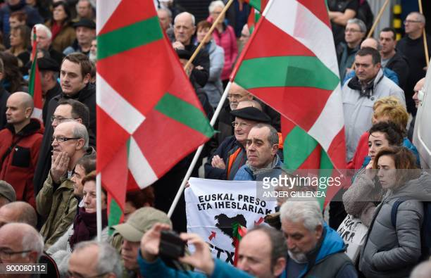 People holding Basque flags gather outside the Martutene prison in San Sebastian during a demonstration demanding the release of prisoners affiliated...