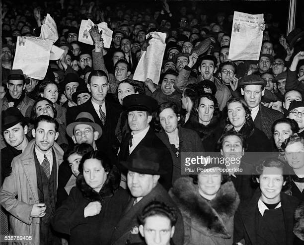 People holding copies of the Communist publication the 'Daily Worker' in Hackney London following the news of a Labour Party win in Bow and Bromley...