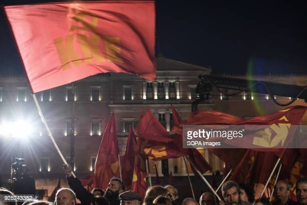 People holding flags during the demonstration Demonstration at Syntagma Square in Athens as general secretary of the Communist Party of Greece...