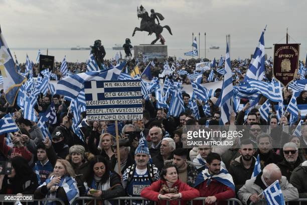 People holding flags of Greece take part in a demonstration to protest against the use of the name Macedonia following the developments on the issue...