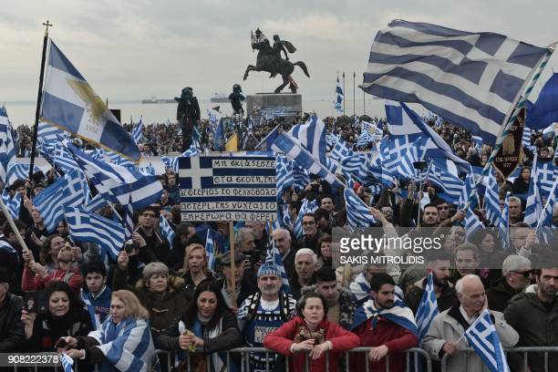 TOPSHOT People holding flags of Greece take part in a demonstration to protest against the use of the name Macedonia following the developments on...