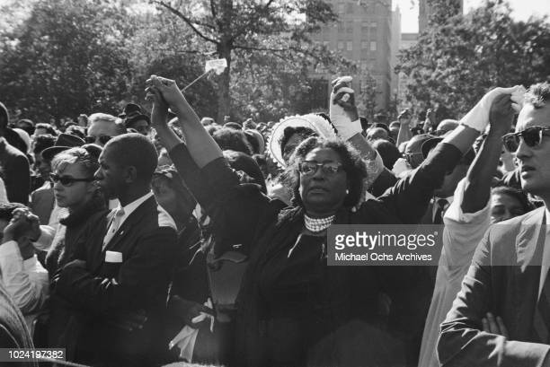 People holding hands at a civil rights demonstration in Washington DC in the aftermath of the 16th Street Baptist Church bombing in Birmingham...