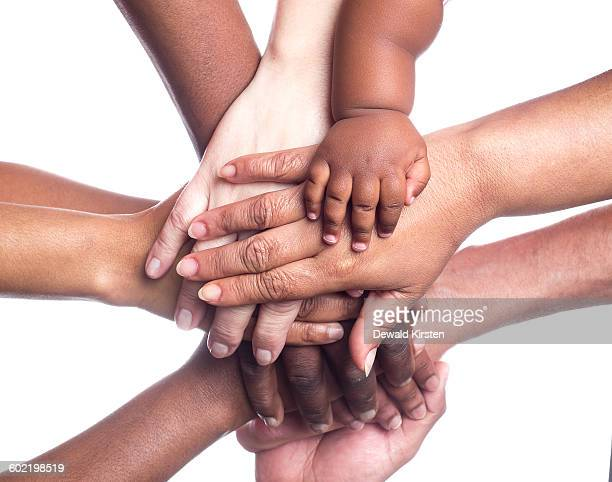 people holding hands on white background - manos en el aire fotografías e imágenes de stock
