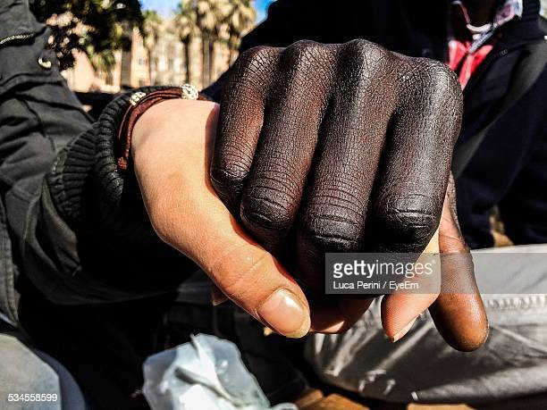 People Holding Hands Showing Interracial