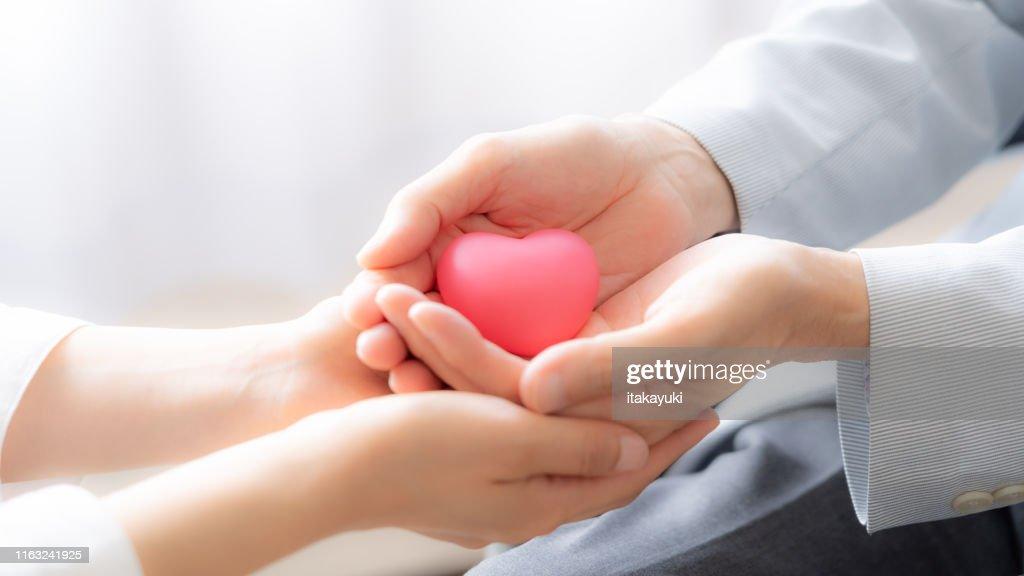 people holding heart symbol : Stock Photo