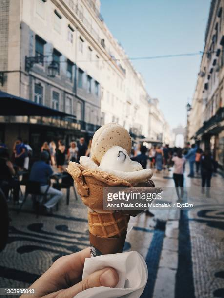 people holding ice cream in city - portugal stock pictures, royalty-free photos & images