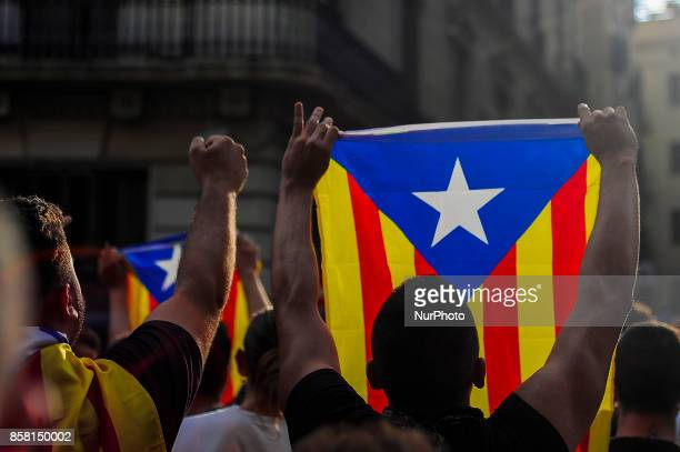 People holding Independentist flags in front the police the day after the Catalonia independence referendum declared ilegal by the Spanish government...