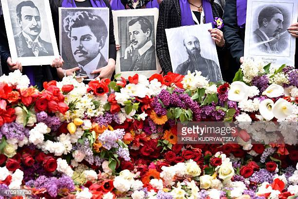 People holding photographs of Armenian writer Krikor Zohrab Armenian poet Ruben Sevak Armenian poet Daniel Varoujan Armenian priest and composer...