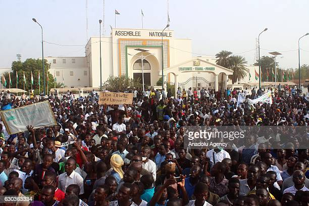 People holding placard march towards parliament building as they stage an antigovernment protest demanding education reform at Toumo Square in Niamey...