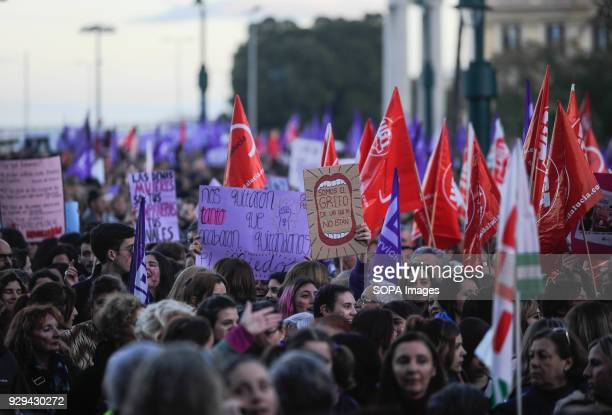 People holding placards and flags as they take part in a nationwide demonstration during the 24hour General Womens Strike in downtown Malaga On this...